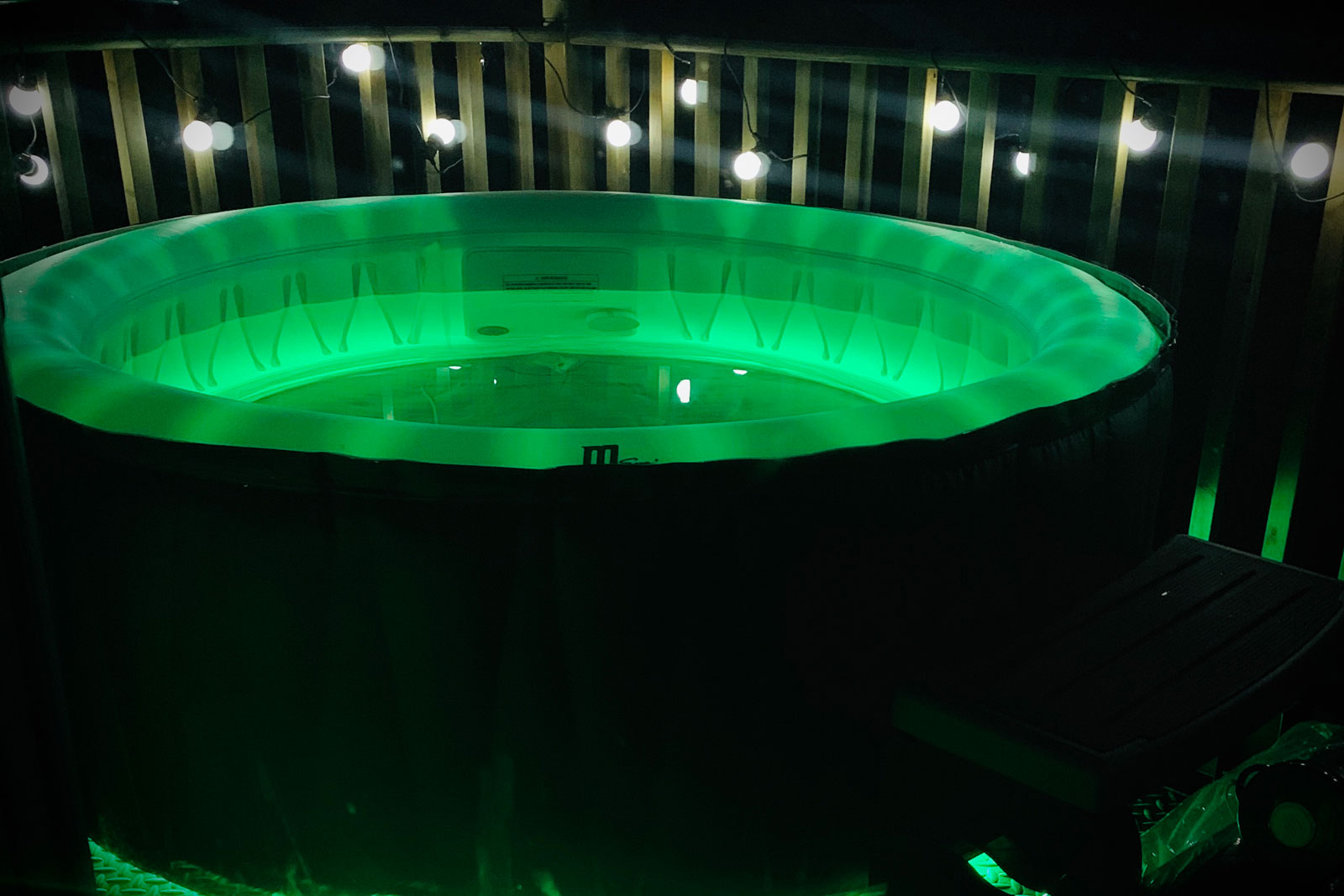 hot tub at night with green light
