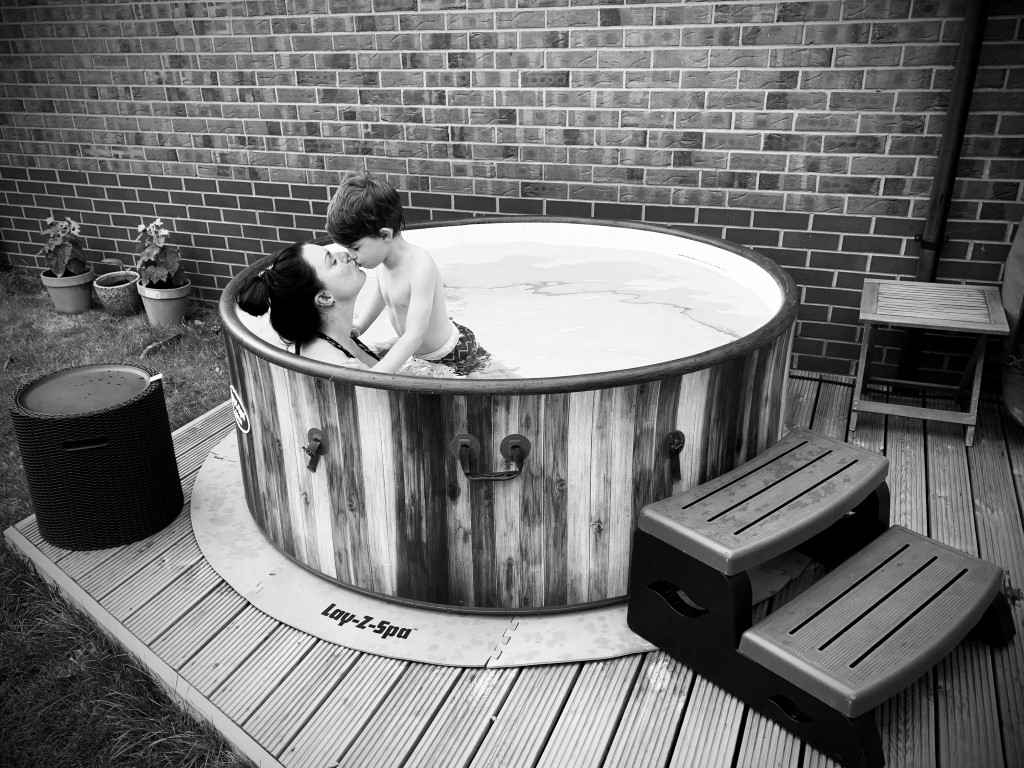 mother and child enjoying a hot tub