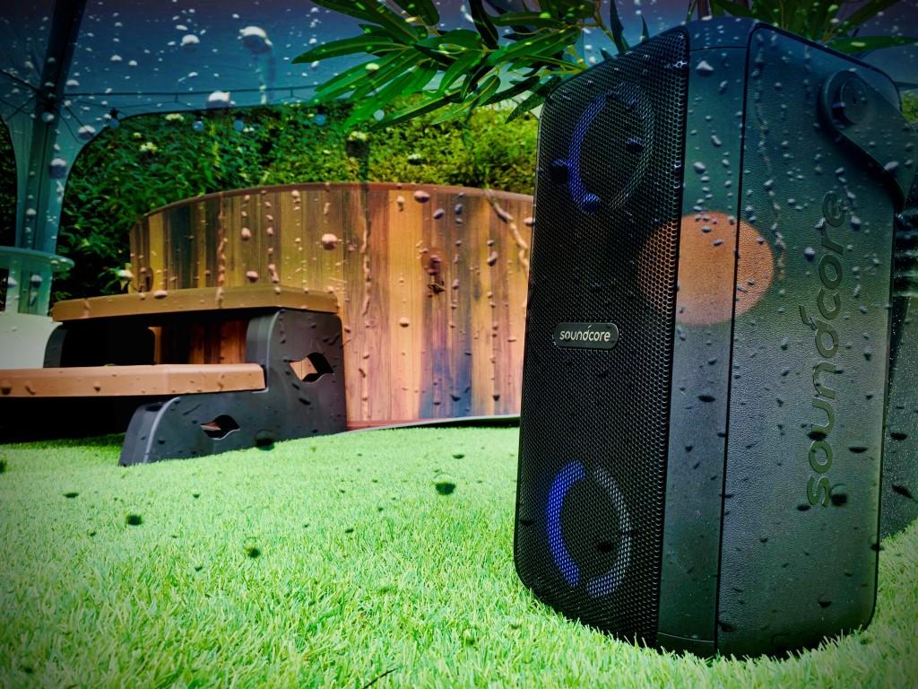 music speaker in front of hot tub